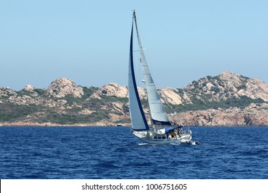 PORTISCO, EMERALD COAST, SARDINIA, ITALY - AUGUST 1ST, 2009: Sailboat navigating along the coast in Sardinia, Italy. The Emerald Coast is one of the favorite destinations for sailors.