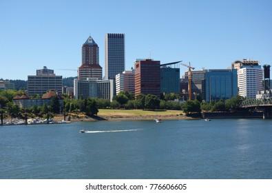 PORTLAND, OR -21 JUL 2017- Day view of the Portland city skyline and the Willamette River near the Hawthorne Bridge in Portland, Oregon.