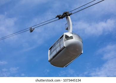 Portland aerial tram for public transportation to Oregon Health and Science University on a cloudy sky