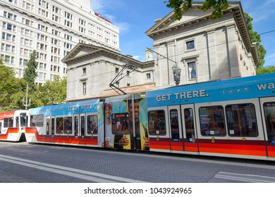 PORTLAND, OR - AUGUST 18, 2017: Train in city center. Portland attracts 5 million tourists annually.