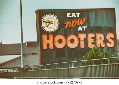 PORTLAND, OR - AUGUST 21, 2017: Hooters sign along city streets. It is part of a US based casual dining chain that has locations in several countries.
