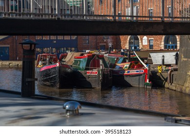 PORTLAND BASIN, ASHTON UNDER LYNE, LANCASHIRE, ENGLAND, UK - MARCH 14, 2016: Barges moored together in Ashton Basin canal marina.