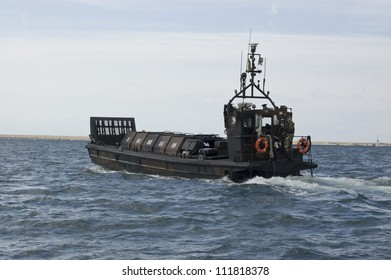PORTLAND, DORSET, ENGLAND - AUGUST 31: Royal Marine landing craft patrolling Portland Harbour on August 31 2012.  The Royal Navy is protecting events at the Paralympic Games in the area.