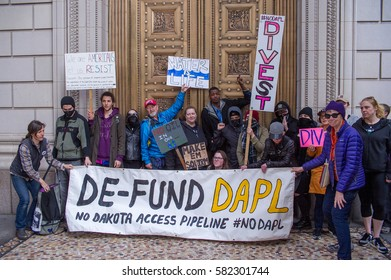 PORTLAND, OR - FEBRUARY 16, 2017: Protest at Pioneer Courthouse Square  in solidarity with Standing Rock Tribe directed at taking action to major banks who support the North Dakota Access Pipeline.