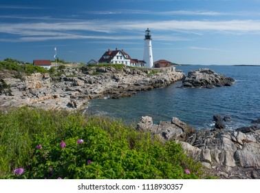 Portland Head Lighthouse with bay and sea roses