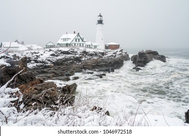 Portland Head Lighthouse covered in snow following a snow storm.