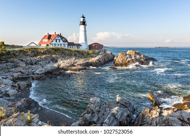 Portland Head lighthouse with the rocky coastline in the foreground. Portland, Maine, United States.