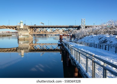 PORTLAND, OR - JANUARY 12: Eastbank Esplanade in Portland, OR with the Moda Center in the background on January 12, 2017