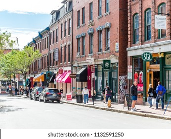 PORTLAND, MAINE - September 13, 2014: Tourism is a huge part of Portland's economy, as cruise ships bring in thousands of tourists to restaurants, bars, landmarks & shopping in the waterfront area.