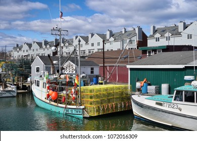 PORTLAND, MAINE, USA - APRIL, 2018: A fishing wharf in the old port with boats and lobster traps