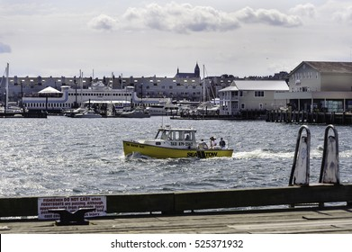 Portland, Maine, USA - August 9, 2009: Water taxi makes its way into Casco Bay from Portland docks