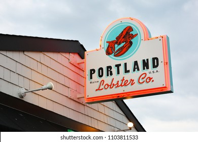 Portland, Maine USA - May 26, 2018: The Sign of Portland Lobster Company after sunset. Portland Lobster Company is a historical seasonal waterside lobster shack at Portland, ME.