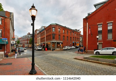 Portland, Maine USA - May 26, 2018: Corner of Market and Fore St of Historical Portland Old Port after sunset. The Old Port is known for its cobblestone streets, old brick buildings and fishing pier.