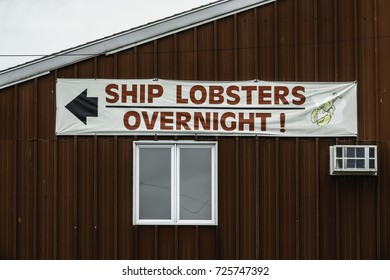 PORTLAND, MAINE/USA - SEPTEMBER 22, 2017: Exterior wall sign in waterfront district of downtown Portland, Maine, USA, for themes of seafood, supply and demand, freshness.