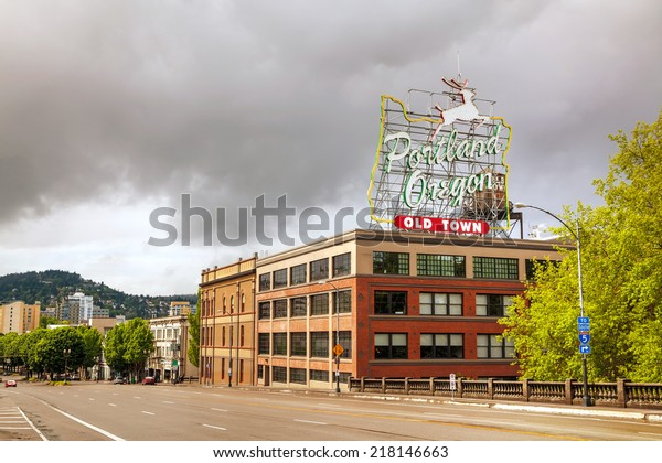 PORTLAND- MAY 04: Famous Old Town Portland Oregon neon sign on May 04, 2014 in Portland, Oregon. The sign faces westbound traffic as it enters downtown Portland coming across the Willamette River.