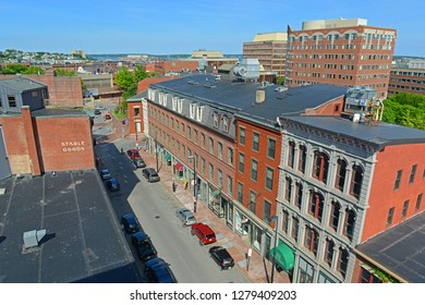 PORTLAND, ME, USA - JUN 20, 2015: Portland historic Free Street is filled with 19th century brick buildings and is now the commercial center of the city in Portland, Maine, USA.