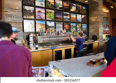 PORTLAND, OR - OCTOBER 24, 2015: Bar and tap handles at Basecamp Brewing Company, a popular craft brewery in Portland Oregon.