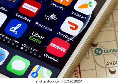 Portland, OR, USA - Apr 30, 2020: Mobile app icons of assorted food delivery services are seen on a smartphone, including DoorDash, Grubhub, Uber Eats, delivery.com, Seamless, Postmates and Instacart.