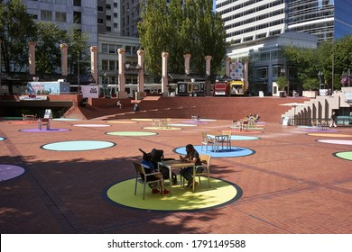 "Portland, OR, USA - Aug 5, 2020: Colorful social distancing circles in Portland's Pioneer Courthouse Square. The art installation, ""Polka Dot Courthouse Square"", will be in place through September."