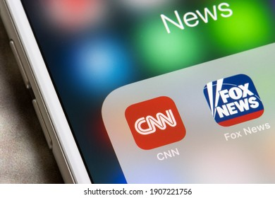 Portland, OR, USA - Feb 1, 2021: CNN and Fox News mobile app icons are seen on an iPhone. Leaning left (liberal) news versus leaning right (conservative) news.