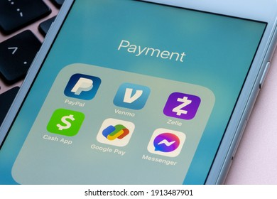 Portland, OR, USA - Feb 9, 2021: Assorted apps for payment are seen on an iPhone - PayPal, Venmo, Zelle, Cash App, Google Pay, and Facebook Messenger.