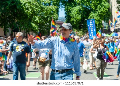 Portland OR, USA - June 17, 2018: US Senator Ron Wyden waves the crowd during the 2018 Pride Parade through the streets of downtown Portland.