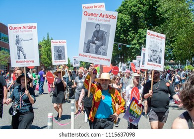 Portland OR, USA - June 17, 2018: A group pay in their signs respect for queer artist during the 2018 Pride Parade through the streets of downtown Portland.