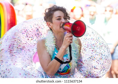 Portland OR, USA - June 17, 2018: A woman thanks the crowd for their support during the 2018 Pride Parade through the streets of downtown Portland.