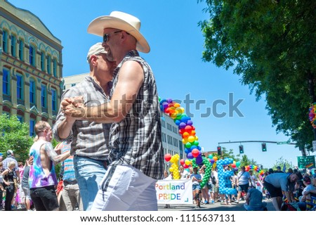 Portland OR, USA - June 17, 2018: A men couple dance country music during the 2018 Pride Parade through the streets of downtown Portland.