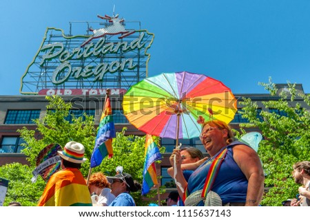 Portland OR, USA - June 17, 2018: The crowd moves under the famous Portland Sign during the 2018 Pride Parade through the streets of downtown Portland.