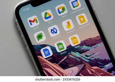Portland, OR, USA - Mar 10, 2021: Google Workspace (formerly G Suite) apps are seen on an iPhone - Gmail, Drive, Meet, Calendar, Chat, Currents, Jamboard, Keep, Docs, Sheets, and Slides.