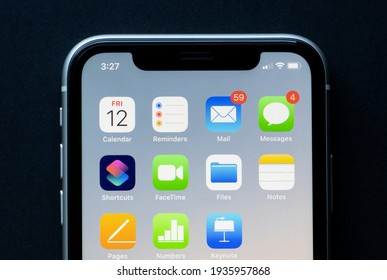 Portland, OR, USA - Mar 12, 2021: Productivity apps by Apple are seen on an iPhone - Calendar, Reminders, Mail, Messages, Shortcuts, FaceTime, Files, Notes, Pages, Numbers, and Keynote.