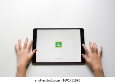 Portland, OR, USA - Mar 14, 2020: A child using the Google Classroom mobile app from her iPad. The app aims to simplify creating, distributing, and grading assignments for schools in a paperless way.