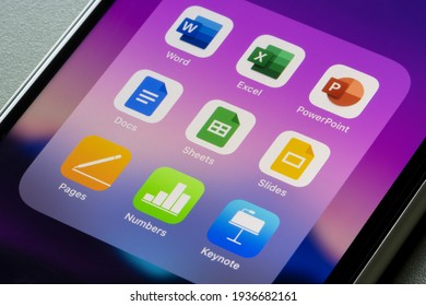 Portland, OR, USA - Mar 15, 2021: Office suites of apps created by Microsoft, Google, and Apple are seen on an iPhone - Word, Excel, PowerPoint, Docs, Sheets, Slides, Pages, Numbers, and Keynotes.