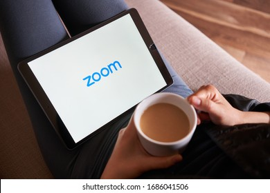 Portland, OR, USA - Mar 28, 2020: A woman using Zoom mobile app to join a meeting from her iPad. Zoom is a cloud-based video conferencing tool that enables video conferences, webinars, live chat, etc.