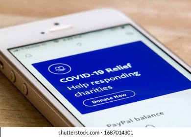 Portland, OR, USA - Mar 29, 2020: COVID-19 Relief donation page is seen when launching the PayPal mobile app on a smartphone.