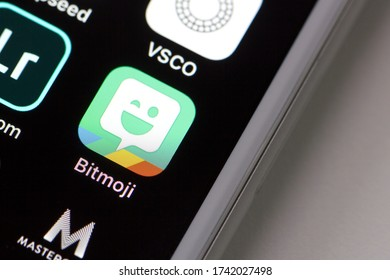 Portland, OR, USA - May 26, 2020: Bitmoji mobile app icon is seen on an iPhone. Bitmoji is a secondary social media app that enables users to create little cartoon versions of themselves.