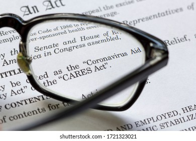 Portland, OR, USA - May 3, 2020: Closeup of the Coronavirus Aid, Relief, and Economic Security Act document. The CARES Act is meant to address the economic fallout of the 2020 coronavirus pandemic.