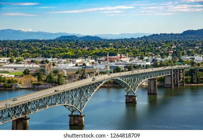 Portland, Oregon - 8/27/2013:  Ross Island bridge crosses the Willamette River in Downtown Portland, Oregon