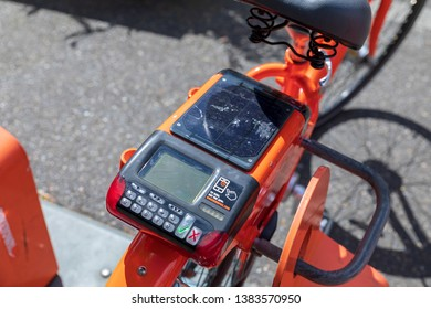 Portland, Oregon - April 27, 2019 : Biketown bicycle sharing and rental program with a solar powered charging station