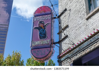 Portland, Oregon - April 27, 2019 : Voodoo doughnuts neon sign on the building in downtown Portland