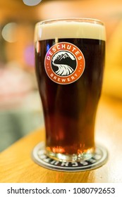 PORTLAND, OREGON - CIRCA NOVEMBER 2017: A cold foamy beer is enjoyed in a pint glass at the Deschutes Public House in Portland, Oregon.