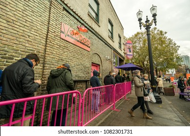 PORTLAND, OREGON - CIRCA NOVEMBER 2017: Hungry people wait in line for delicious and unique donuts at VooDoo Doughnuts in Portland, Oregon.