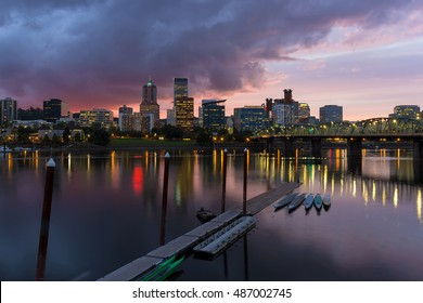 Portland Oregon city downtown waterfront skyline along Willamette River after sunset at dusk