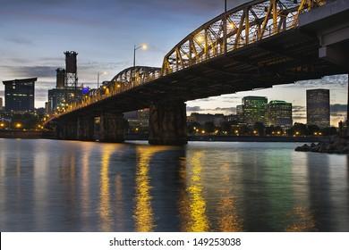 Portland Oregon City Skyline Under Hawthorne Bridge by the Bank of Willamette River at Dusk