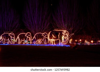 Portland, Oregon - December 05 2009:  Christmas decoration at Portland Zoo during Zoolights week. A family of elephans walking on a field