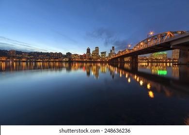 Portland Oregon Downtown City Skyline Along Willamette River by the Hawthorne Bridge at Evening Blue Hour
