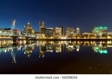 Portland Oregon downtown city skyline reflection on Willamette River during evening blue hour