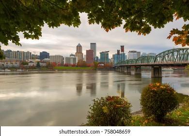 Portland Oregon downtown city skyline framed by fall season foliage along Willamette River