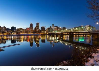 Portland Oregon downtown skyline along Willamette River winter night scene